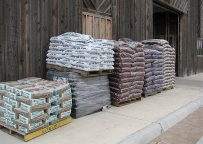 Bags of goods stacked in front of Home Lumber, Plains, Kansas.